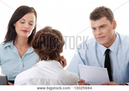 Business coaching concept. Young woman being interviewed for a job.  Isolated on white background