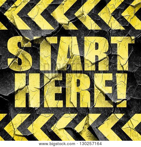 start here!, black and yellow rough hazard stripes