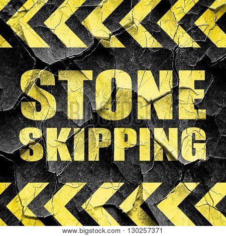 stone skipping, black and yellow rough hazard stripes