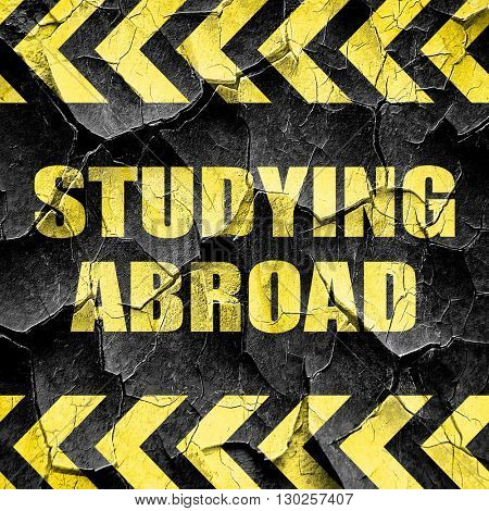 studying abroad, black and yellow rough hazard stripes