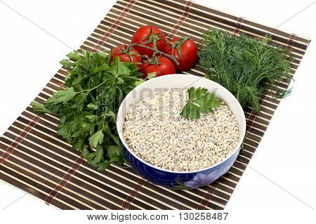 plate with pearl barley nearby parsley tomatoes fennel on a rug a subject products vegetables