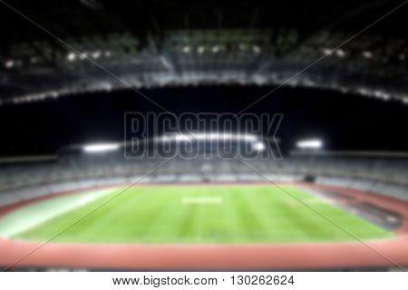 defocused background of soccer or football stadium at twilight
