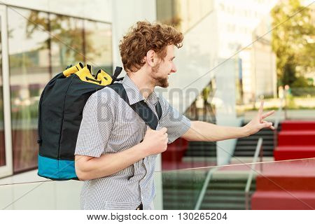 Man tourist backpacker outdoor in city. Adventure summer tourism active lifestyle. Young bearder guy tramping