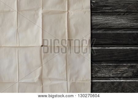 Old paper. Vintage letter on table. Paper sheet and wooden background. Retro composition with letters and paper.