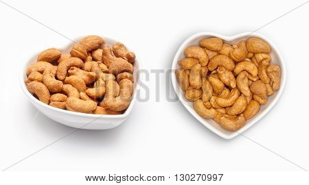 cashew nut  in a heart shaped bowl, isolated on white