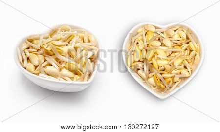 Fresh soya  in a heart shaped bowl, isolated on white
