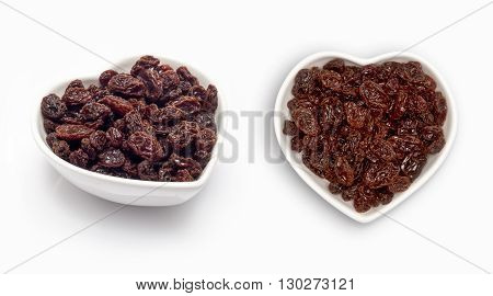 raisins in a heart shaped bowl, isolated on white