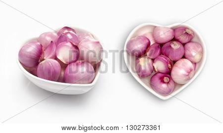 Shallot in a heart shaped bowl, isolated on white
