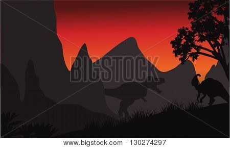 tyrannosaurus and parasaurolophus silhouette in hills at the sunsrise