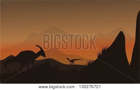 On the hills silhouette eoraptor and parasaurolophus at afternoon