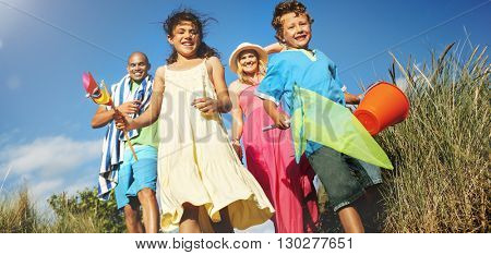 Cheerful Family Bonding by the Beach Holiday Concept