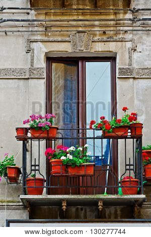 The Italian Balcony Decorated With Fresh Flowers