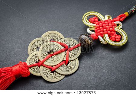 chinese coins of luck on black background.