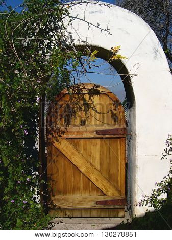 a picture of an exterior adobe 19th century arch entry way