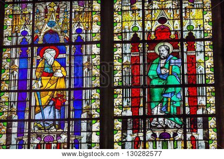 PARIS, FRANCE - MAY 31, 2015 Saint Paul with Sword Saint Boniface with Axe Stained Glass Saint Severin Church Paris France. Saint Severin one of oldest churches Paris located in the Latin Quarter. Built in the 1500s