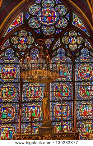 PARIS, FRANCE - MAY 31, 2015 Mary Statues Candles Stained Glass Notre Dame Cathedral Paris France. Notre Dame was built between 1163 and 1250 AD.