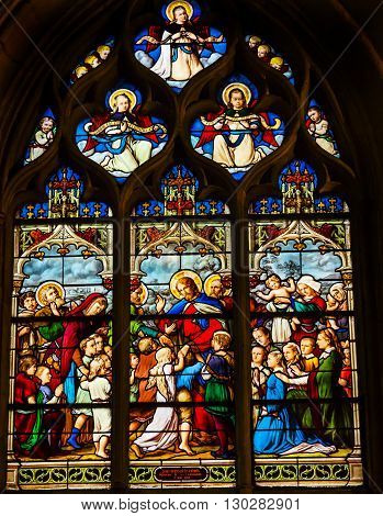 PARIS, FRANCE - MAY 31, 2015 Jesus Christ Children Suffer the Little children to come to me Angels Stained Glass Saint Severin Church Paris France. Saint Severin one of oldest churches Paris located in the Latin Quarter. Built in the 1500s