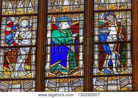 PARIS, FRANCE - MAY 31, 2015 Saint Sebastian Saint t Patrick Risen Jesus Christ Stained Glass Saint Severin Church Paris France. Saint Severin one of oldest churches Paris located in the Latin Quarter. Built in the 1500s
