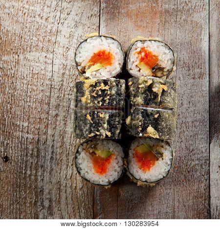 Tempura Maki Sushi - Deep Fried Roll made of Fresh Raw Salmon, Avocado, Cucumber and Cream Cheese inside