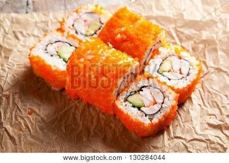 California Maki Sushi with Masago  - Roll made of Crab Meat, Avocado, Cucumber inside. Smelt roe outside