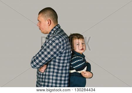 Problems between father and son , isolated on grey background
