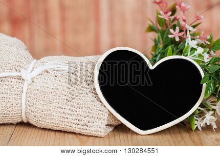 Bouquet of dried flowers with wooden heart shape