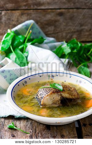 Soup with a sorrel fish. Selective focus. Style rustic