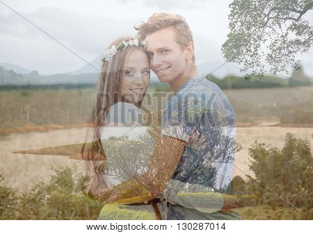summer holidays, love, romance and people concept - happy smiling young hippie couple hugging over natural background with double exposure effect