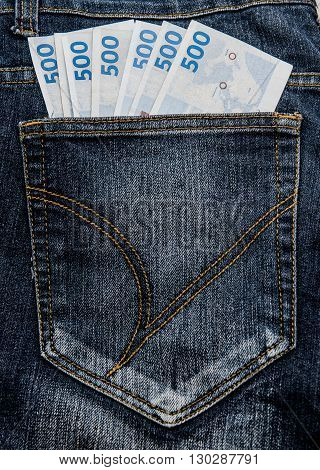 Jean pocket with some money, Danish currency