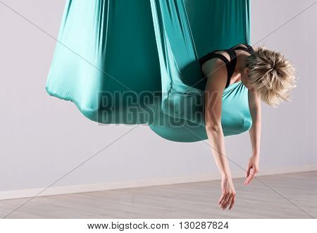 Woman Stretching In Aerial Yoga Blanket