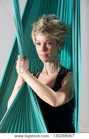Woman Holding On To Green Aerial Yoga Tarp