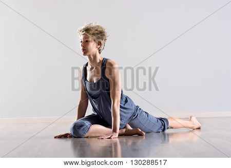 Woman Stretching Legs And Hamstring Muscles