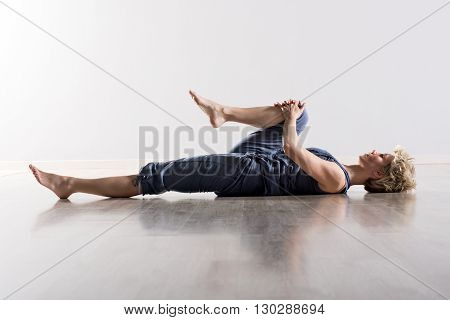 Woman Holding Knee While Stretching Hamstring