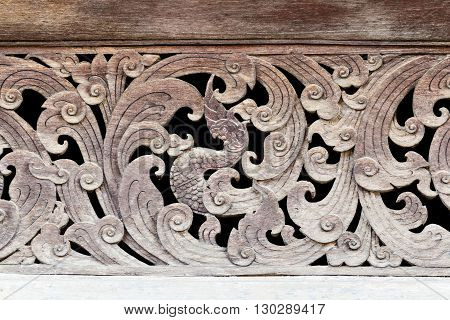 Ancient Naga Wood Carving In Thai Temple