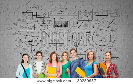 education, school and people concept - group of smiling teenage students with folders and school bags over gray brick wall background with scheme drawing