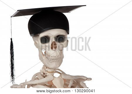 A smiling skull celebrates graduation day after a long battle.