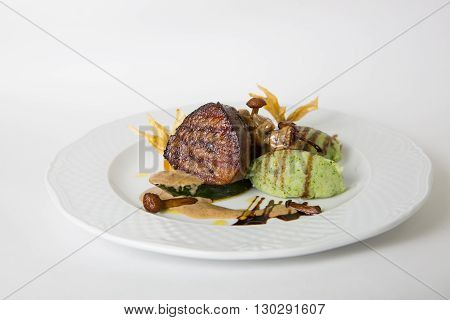 Mignon meat steak served with mushroom garnish
