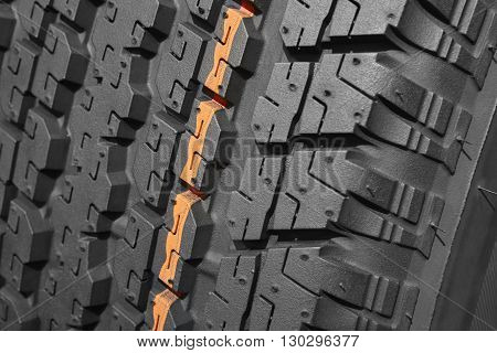 Brand new all terrain tyre macro detail. Vehicle wheel. Horizontal