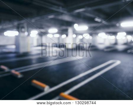 Blurred car park indoor Office Building Basement with Neon Lighting