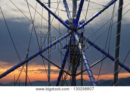 metallic web structure with blue lights close up detail