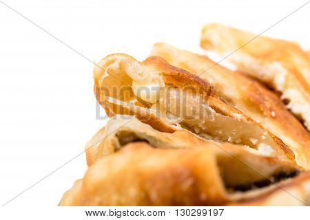 Delicious sliced puff pie stuffed with mushrooms. Macro. Photo can be used as a whole background.