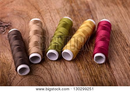 five cotton sewing autumn color on wood