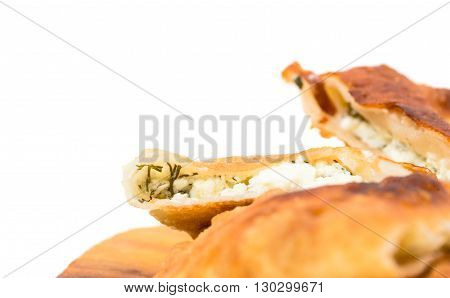 Delicious sliced puff pie with curd cheese and fresh dill. Macro. Photo can be used as a whole background.