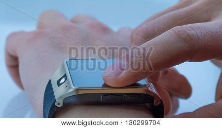 Man Using Smartwatch App With Finger