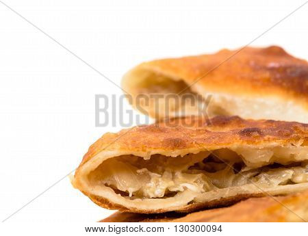 Delicious sliced puff pie stuffed with baked cabbage. Macro. Photo can be used as a whole background.