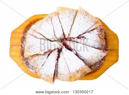 Delicious puff pie with cherry and powdered sugar. Isolated on a white background.
