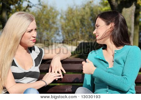 Two friended woman at park talking