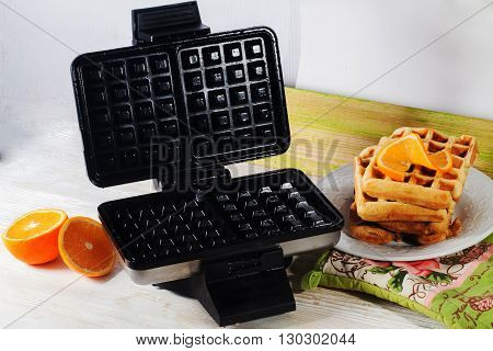 Viennese waffles waffle iron pile of orange Belgian Prague still life