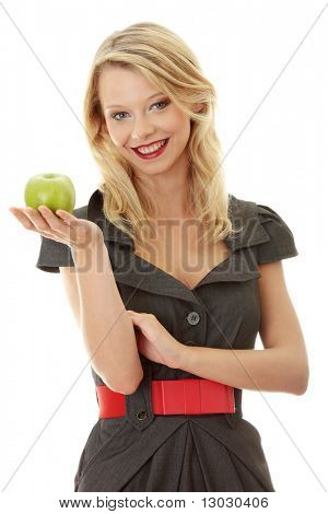 Young blond woman with green apple on her hand - healthy eating concept