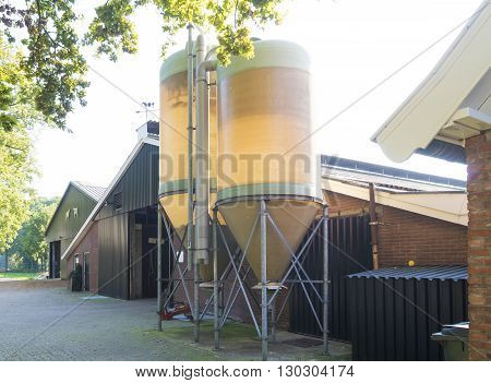 two silos on a dairy farm for animal food storage